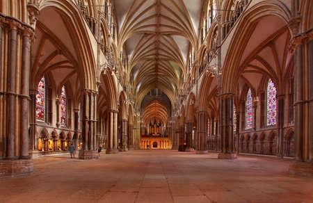 nave: This interior view of the nave in Lincoln cathedral shows the impressive grandeur of this medieval building.