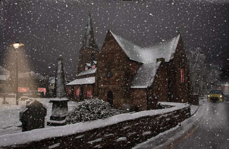 On a winter evening, snow falls on St  Thomas photo