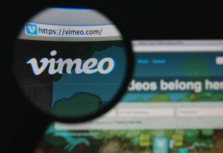 vimeo: LISBON - JANUARY 22, 2014: Photo of Vimeo homepage on a monitor screen through a magnifying glass. Editorial
