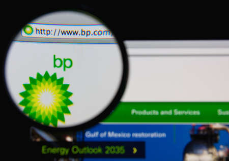 LISBON - JANUARY 20, 2014: Photo of BP homepage on a monitor screen through a magnifying glass.