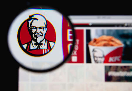 LISBON - JANUARY 19, 2014: Photo of KFC homepage on a monitor screen through a magnifying glass. Editorial