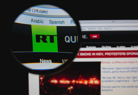 LISBON - JANUARY 23, 2014: Photo of RT homepage on a monitor screen through a magnifying glass.