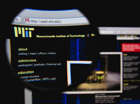 institute of technology: LISBON - JANUARY 25, 2014: Photo of Massachusetts Institute of Technology homepage on a monitor screen through a magnifying glass.