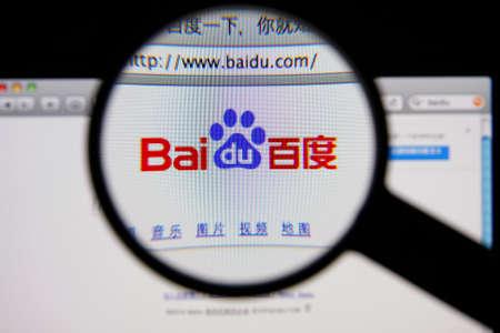 LISBON - JANUARY 14, 2014: Photo of Baidu homepage on a monitor screen through a magnifying glass. Фото со стока - 34778258