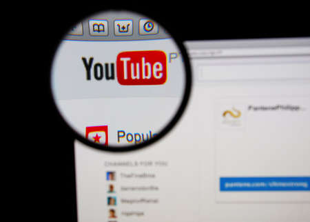 youtube: LISBON - JANUARY 14, 2014: Photo of Youtube homepage on a monitor screen through a magnifying glass.
