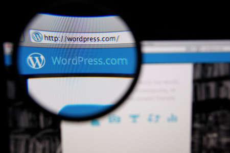 LISBON, PORTUGAL - FEBRUARY 5, 2014: Photo of WordPress.com homepage on a monitor screen through a magnifying glass. Фото со стока - 34588164