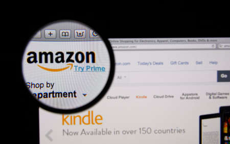 amazon com: LISBON - JANUARY 14, 2014: Photo of Amazon homepage on a monitor screen through a magnifying glass.