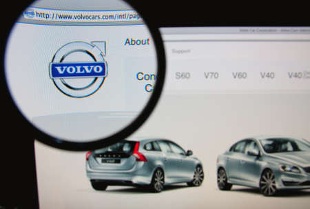 LISBON, PORTUGAL - JANUARY 30, 2014: Photo of Volvo homepage on a monitor screen through a magnifying glass.