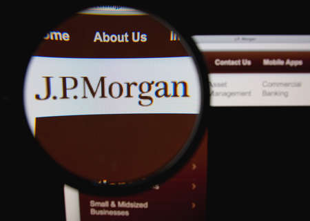 LISBON, PORTUGAL - JANUARY 30, 2014: Photo of J.P.Morgan homepage on a monitor screen through a magnifying glass.