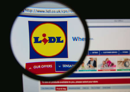 LISBON, PORTUGAL - JANUARY 30, 2014: Photo of Lidl homepage on a monitor screen through a magnifying glass.