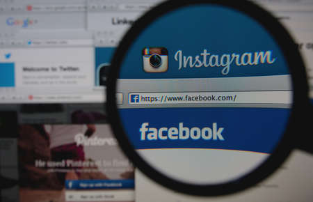 LISBON - JANUARY 29, 2014: Photo of Instagram and Facebook homepage on a monitor screen through a magnifying glass among other popular social networking sites.