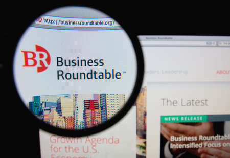 roundtable: LISBON, PORTUGAL - FEBRUARY 6, 2014: Photo of Business Roundtable homepage on a monitor screen through a magnifying glass.