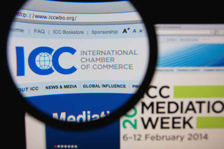 international organization: LISBON, PORTUGAL - FEBRUARY 6, 2014: Photo of the International Chamber of Commerce homepage on a monitor screen through a magnifying glass. Editorial