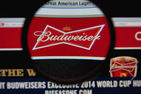 budweiser: LISBON - JANUARY 29, 2014: Photo of Budweiser homepage on a monitor screen through a magnifying glass.