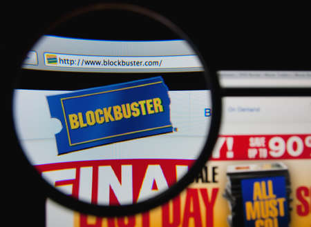 blockbuster: LISBON, PORTUGAL - FEBRUARY 3, 2014: Photo of Blockbuster homepage on a monitor screen through a magnifying glass.