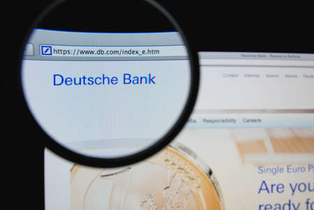 LISBON, PORTUGAL - JANUARY 30, 2014: Photo of Deutsche Bank homepage on a monitor screen through a magnifying glass.