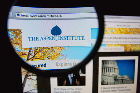humanistic: LISBON, PORTUGAL - FEBRUARY 6, 2014: Photo of The Aspen Institute homepage on a monitor screen through a magnifying glass. Editorial