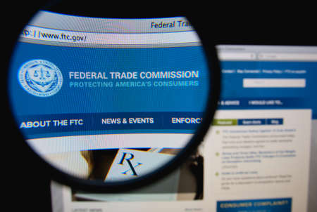 LISBON, PORTUGAL - FEBRUARY 8, 2014: Photo of the Federal Trade Commission homepage on a monitor screen through a magnifying glass. 에디토리얼