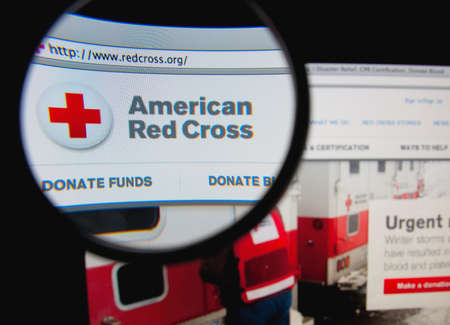 LISBON, PORTUGAL - FEBRUARY 8, 2014: Photo of the American Red Cross homepage on a monitor screen through a magnifying glass. Фото со стока - 34841066