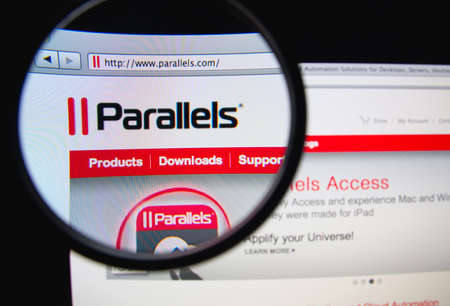 parallels: LISBON, PORTUGAL - FEBRUARY 17, 2014: Photo of Parallels homepage on a monitor screen through a magnifying glass. Editorial