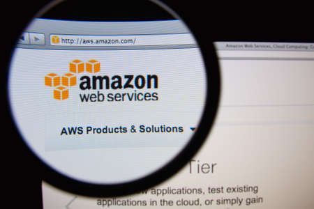 LISBON, PORTUGAL - FEBRUARY 19, 2014: Amazon Web Services homepage through a magnifying glass. Éditoriale
