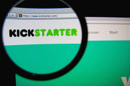 LISBON, PORTUGAL - FEBRUARY 19, 2014: Kickstarter homepage through a magnifying glass. Kickstarter is a crowdfunding platform.