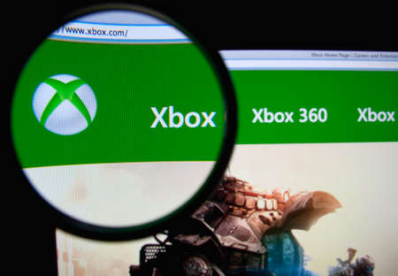 xbox: LISBON, PORTUGAL - FEBRUARY 19, 2014: Photo of the Xbox homepage on a monitor screen through a magnifying glass.