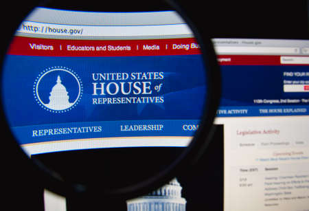 representatives: LISBON, PORTUGAL - FEBRUARY 19, 2014: The United States House of Representatives homepage through a magnifying glass.