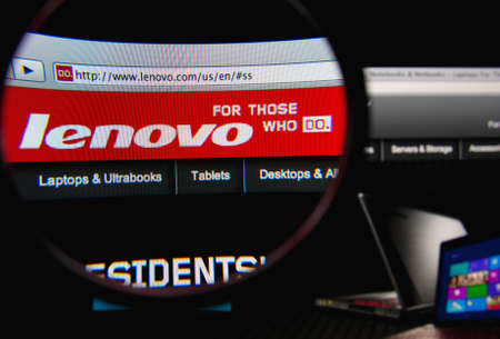 LISBON, PORTUGAL - FEBRUARY 19, 2014: Photo of Lenovo homepage on a monitor screen through a magnifying glass.