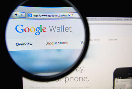 google: LISBON, PORTUGAL - FEBRUARY 19, 2014: Photo of Google Wallet homepage on a monitor screen through a magnifying glass. Editorial