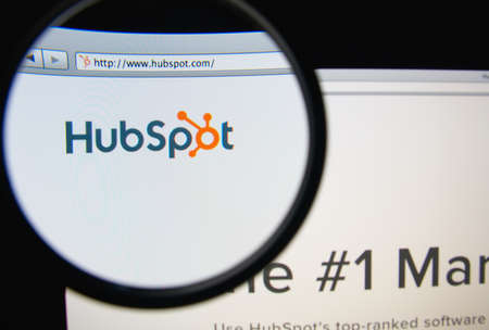 LISBON, PORTUGAL - FEBRUARY 19, 2014: Photo of HubSpot homepage on a monitor screen through a magnifying glass. HubSpot develops and markets a software-as-a-servi ce product for inbound marketing.