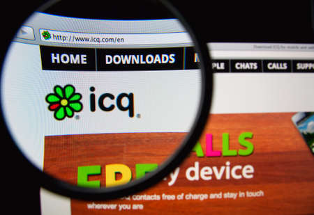 icq: LISBON, PORTUGAL - FEBRUARY 19, 2014: Photo of ICQ homepage on a monitor screen through a magnifying glass.
