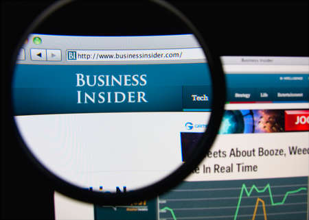 insider information: LISBON, PORTUGAL - FEBRUARY 19, 2014: Photo of Business Insider homepage on a monitor screen through a magnifying glass.