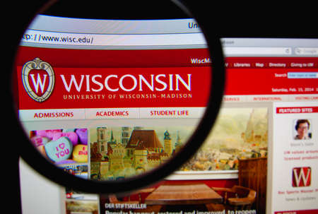 university of wisconsin: LISBON, PORTUGAL - FEBRUARY 22, 2014: Photo of University of Wisconsin - Madison homepage on a monitor screen through a magnifying glass. Editorial