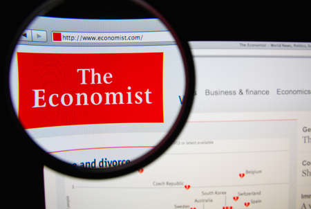 economist: LISBON, PORTUGAL - FEBRUARY 19, 2014: Photo of The Economist homepage on a monitor screen through a magnifying glass. Editorial