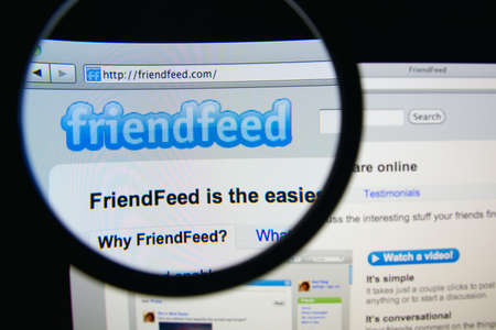 aggregator: LISBON, PORTUGAL - FEBRUARY 19, 2014: Photo of FriendFeed homepage on a monitor screen through a magnifying glass. Editorial