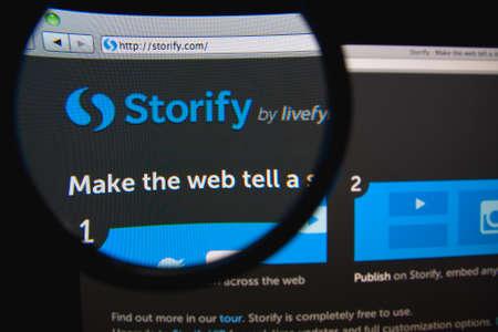 LISBON, PORTUGAL - FEBRUARY 21, 2014: Storify homepage through a magnifying glass. Редакционное