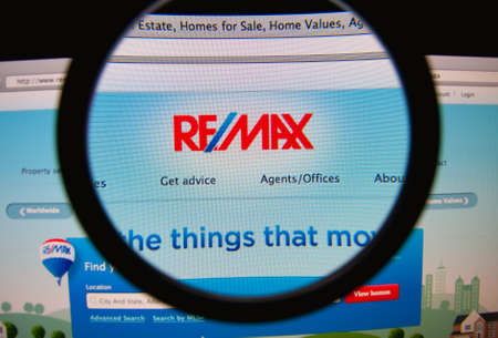 LISBON, PORTUGAL - FEBRUARY 21, 2014: REMAX homepage through a magnifying glass.