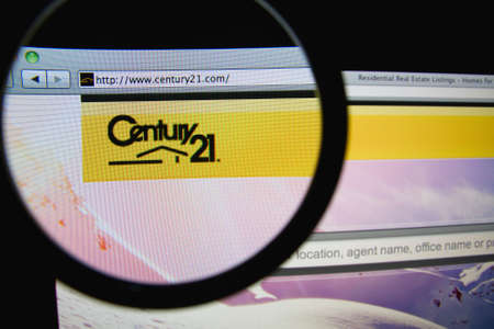 real world: LISBON, PORTUGAL - FEBRUARY 21, 2014: Photo of CENTURY 21 homepage on a monitor screen through a magnifying glass. Editorial