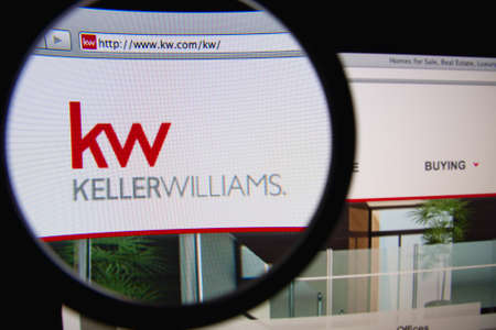LISBON, PORTUGAL - FEBRUARY 21, 2014: Photo of Keller Williams homepage on a monitor screen through a magnifying glass. Редакционное