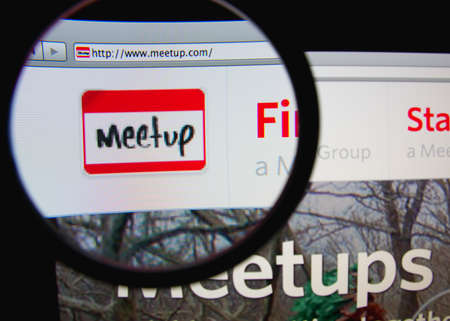 LISBON - FEBRUARY 21, 2014: Meetup homepage through a magnifying glass.
