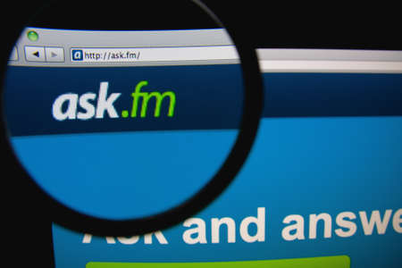LISBON - FEBRUARY 21, 2014: Ask.fm homepage through a magnifying glass.