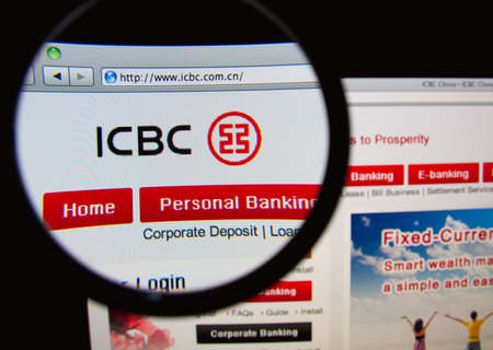 LISBON, PORTUGAL - FEBRUARY 21, 2014: Photo of the Industrial and Commercial Bank of China homepage on a monitor screen through a magnifying glass. Редакционное