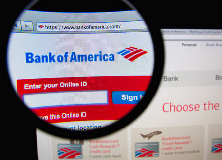 bank of america: LISBON, PORTUGAL - FEBRUARY 21, 2014: Photo of Bank of America homepage on a monitor screen through a magnifying glass.