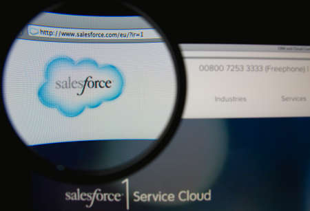 LISBON, PORTUGAL - MARCH 7, 2014: Photo of Salesforce.com homepage on a monitor screen through a magnifying glass. Salesforce.com is a global cloud computing company. 報道画像