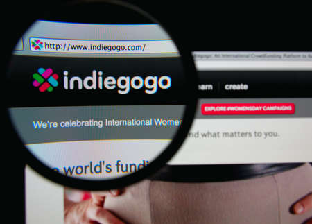 LISBON, PORTUGAL - MARCH 7, 2014: Photo of Indiegogo homepage on a monitor screen through a magnifying glass. Редакционное