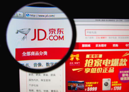 LISBON, PORTUGAL - MARCH 10, 2014: Photo of Jingdong Mall homepage on a monitor screen through a magnifying glass. 報道画像