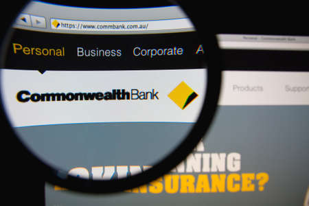 commonwealth: LISBON, PORTUGAL - MARCH 10, 2014: Photo of the Commonwealth Bank of Australia homepage on a monitor screen through a magnifying glass.