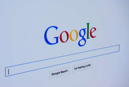 LISBON - JUNE 4, 2014: Photo of Google homepage on a monitor screen.