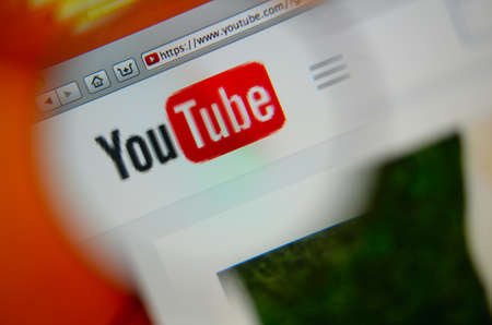 users video: LISBON, PORTUGAL - AUGUST 3, 2014: Photo of Youtube homepage on a monitor screen through a magnifying glass.